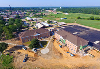 8.5.16 Aerials of football field, residence halls, and track